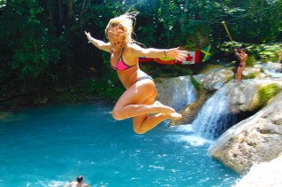 Girl jumping into Blue Hole.