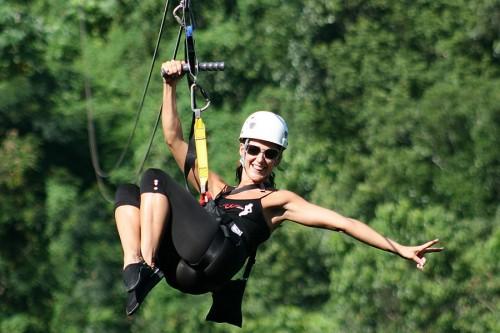 Woman Ziplining at Mystic Mountain in Jamaica
