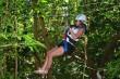Woman having blast riding zipline at Mystic Mountain