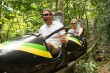 Couple having a blast riding Mystic Mountain Bobsled Ride